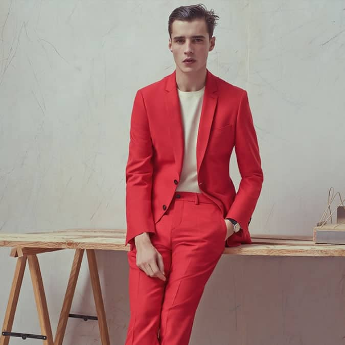 Man in a bold coloured red suit