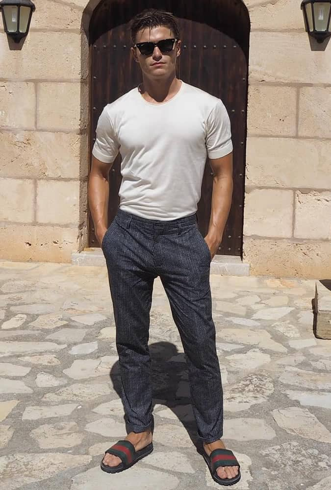 Oliver Cheshire pictured in Majorca wearing printed trousers