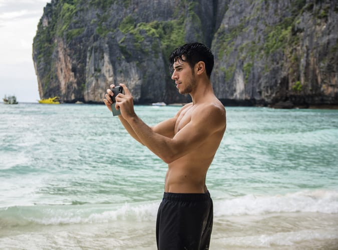 Man Taking A Photo On A Beach