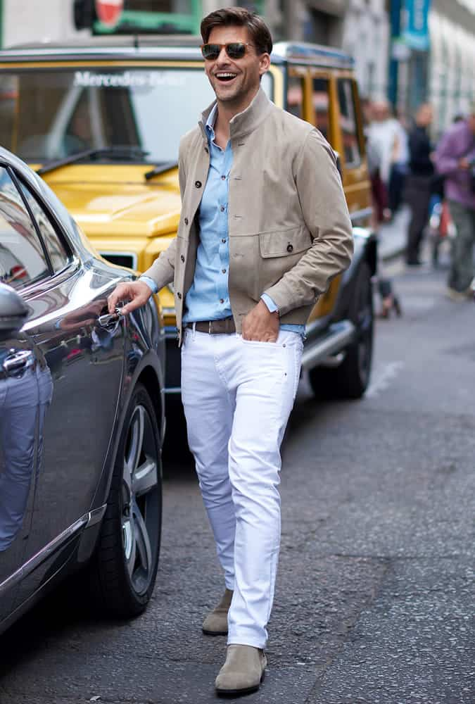 Johannes Hubel in white jeans with a suede bomber jacket