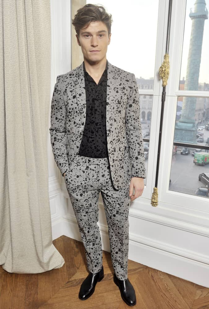 Oliver Cheshire Wearing A Patterned Suit