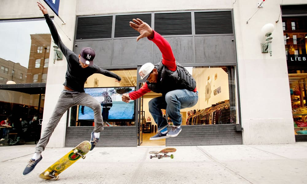 Skateboarders outside the Lafayette Street Supreme store