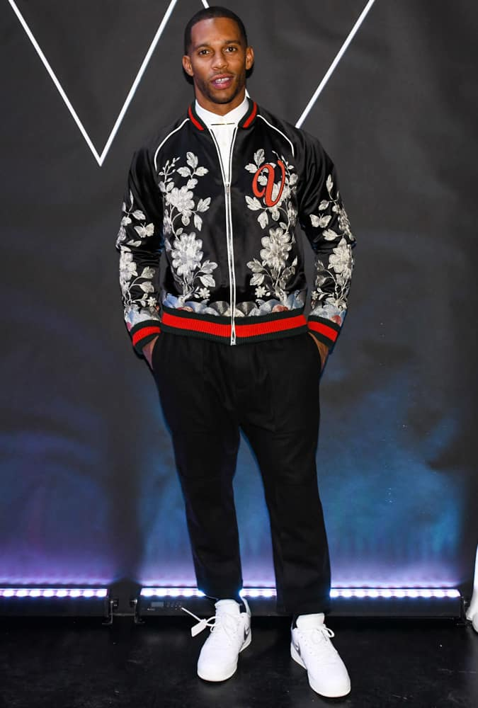 Victor Cruz wearing an embroidered bomber jacket