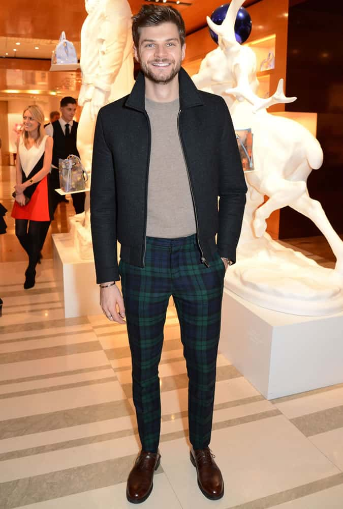 Jim Chapman Wearing A Jacket With Tartan Trousers