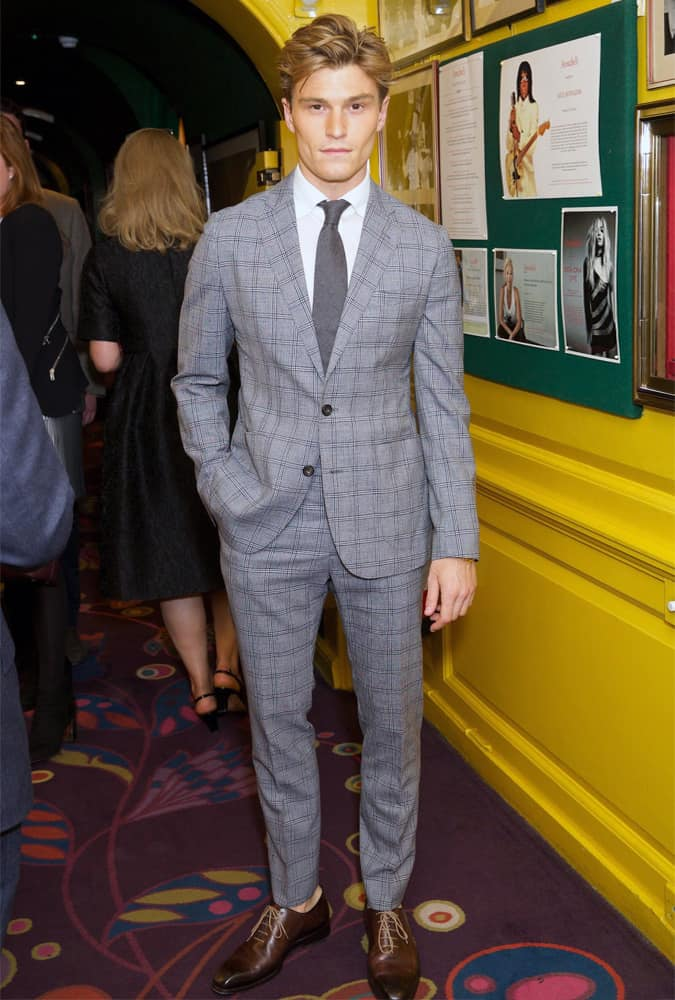 Oliver Cheshire Wearing A Grey Check Suit