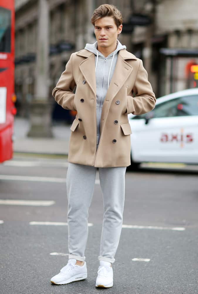 Oliver Cheshire Wearing A Tracksuit And Overcoat